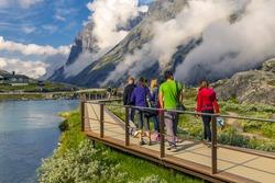 Group of people walking around the Trollstigen, Norway