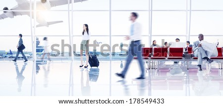 Group of People Walking in the Airport stock photo