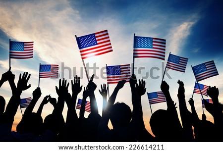 group of people waving american ...