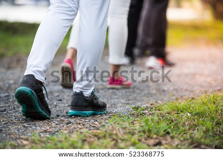group of people wear sport shoes walking, running, traveling, hiking or exercise together outdoors in the park, close up of feet