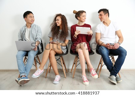 Group of people with digital devices  waiting for interview indoors - Shutterstock ID 418881937