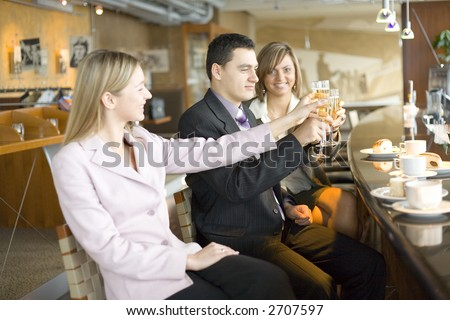 Group of People With Glasses of Champagne. Short Depth of Focus (On Man's Face).