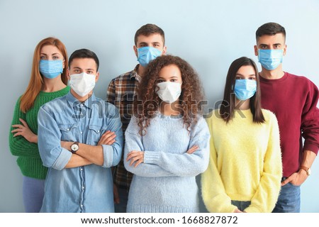 Group of people with protective masks on light background. Concept of epidemic