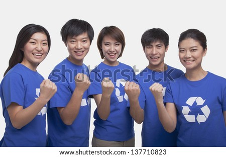 Group of people with raised fists, studio shot