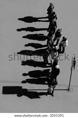group of people with shadow silhouette waiting at the bus stop