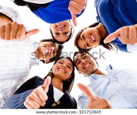 Group of people with thumbs up and smiling
