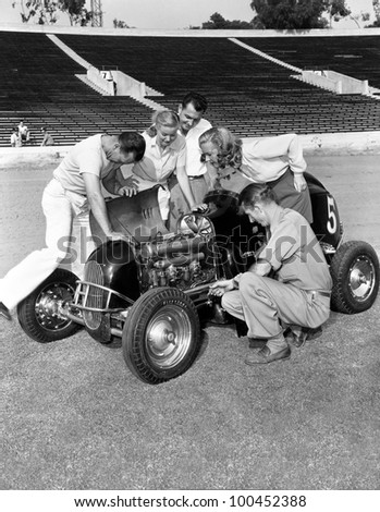 Group of people working on racecar