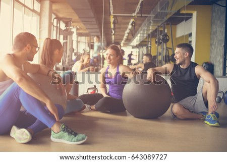 group of people workout in...