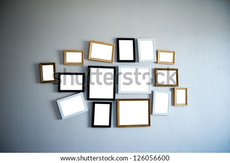 Group of picture frames on the wall.