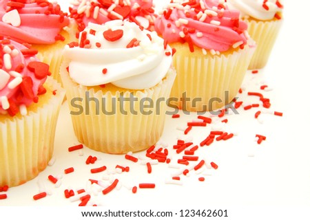 Group of pink and white Valentines Day cupcakes with sprinkles