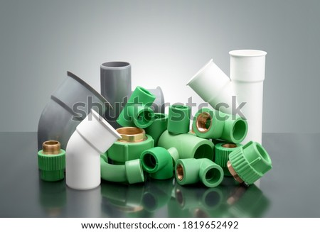 group of Plastic T-tube fittings on Black background, PVC Pipe connections, PVC Pipe fitting, PVC Coupling