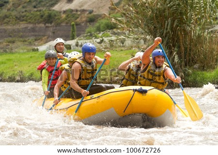 GROUP OF POWERFUL YOUNG MEN ON A RAFTING BOAT PATATE RIVER, ECUADOR