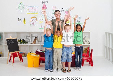 group of preschool kids and teacher in classroom