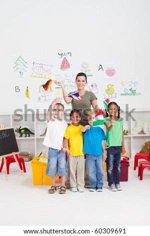 group of preschool kids and teacher with flags in classroom