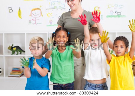 group of preschool kids with hand paint in classroom