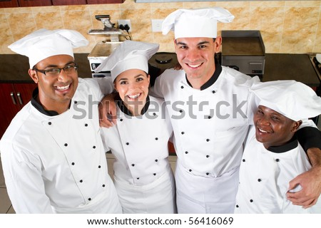 group of professional chefs in commercial kitchen