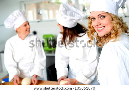 Group of professional female chefs in commercial kitchen