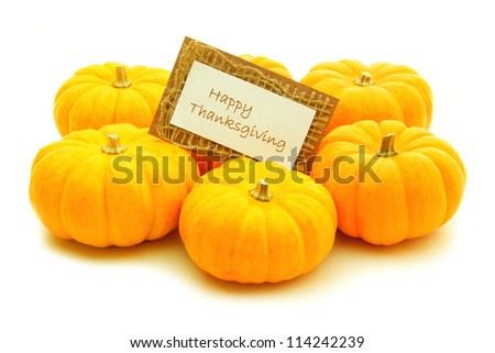 Group of pumpkins with Happy Thanksgiving card over white