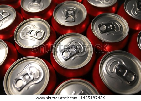 Group of red aluminum soda cans grouped together top view