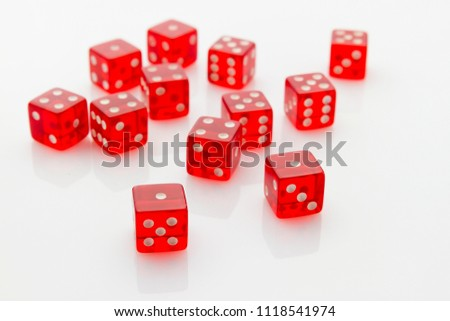 group of red transparent dice laying in mess on white reflective background #1118541974