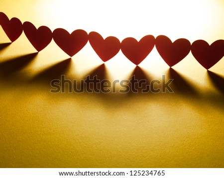 Group of red valentine hearts in chain - stock photo