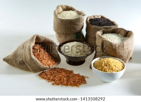 Group of Rice - variety of Rice - basmati, brown, white, jasmine,long grain, medium grain, short grain, in bowls and gunny sacks #1413508292