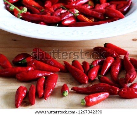 Group of ripened Capsicum annuum_poinsettia, very hot peppers on wooden table, Picture design for foods background.