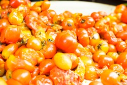 group of rotten tomatoes , unhealthy food with fungus on them are on sale in a local shop in Africa