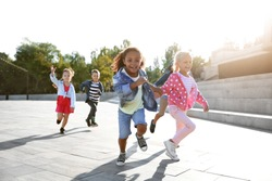 Group of running children outdoors