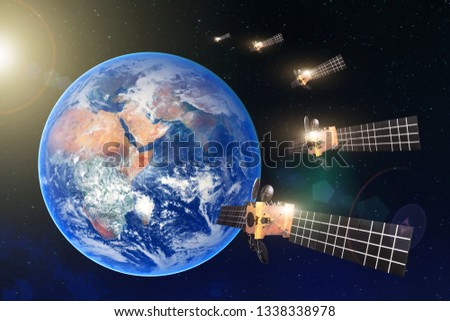 Group of satellites in a row in the geostationary orbit of the Earth, for communication and monitoring systems. Elements of this image furnished by NASA