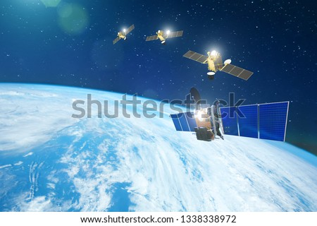 Group of satellites in a row orbiting the earth, for communication and monitoring systems. Elements of this image furnished by NASA #1338338972
