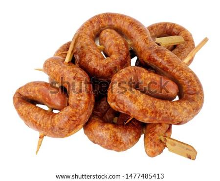 Group of savoury buffet mini party bratwurst sausage swirls isolated on a white background