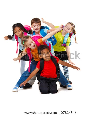 Group of school aged kids with backpacks