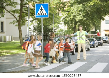 Group of school children crossing street at crosswalk