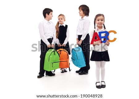 Group of school kids with colorful bags - isolated
