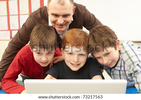 Group Of Schoolboys In IT Class Using Computer