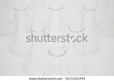 Group of scientific laboratory glass erlenmeyer flask isolated on white background
