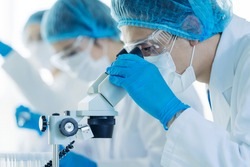 Group of scientist in the laboratory. Medical examination. Drug discovery.