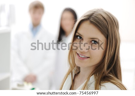 group of scientists working at the laboratory, young beauty female researcher in the front