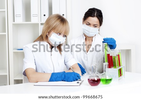 group of scientists working in laboratories with equipment