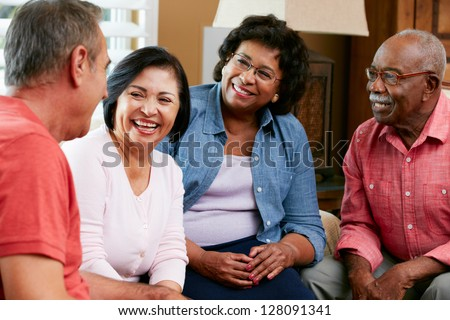 Group Of Senior Friends Chatting At Home Together
