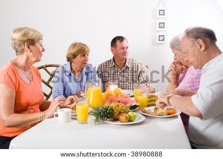 group of senior friends having breakfast