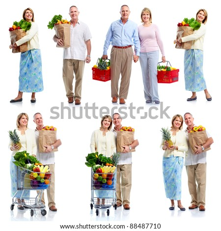 Group of senior people holding shopping bag with food products. Isolated over white background.