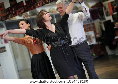 Group of senior people in dancing class with dance teacher