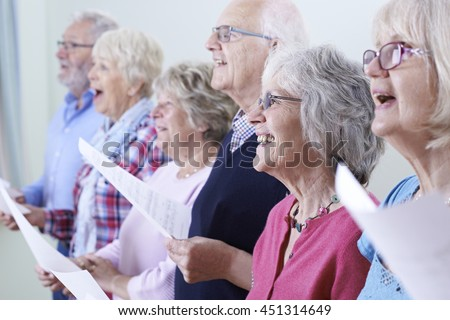 Group Of Seniors Singing In Choir Together Stock photo ©