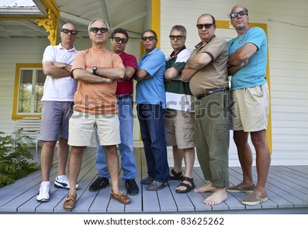 Group of serious men - stock photo