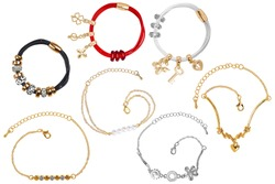 Group of seven elegant silver, gold and textile bracelets, with precious stones, pearls and little charms, isolated on white background, clipping paths included