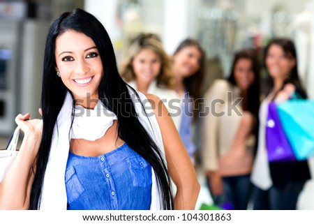 Group of shopping women at the mall smiling
