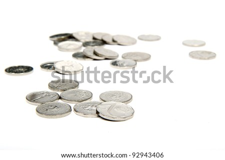 group of silver coins on white background