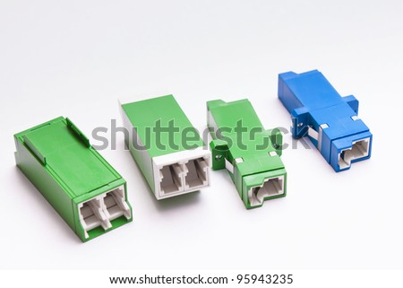Group of singlemode and multimode fiber optic adapters SC and LS